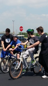 Children supported by CRP program learning to ride bikes and enjoy summer at Bike Camp.