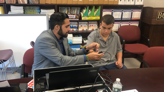 New York Life representative connects with BCCS student for Child ID Card.