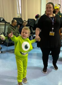 A preschooler dressed as a monster arrives