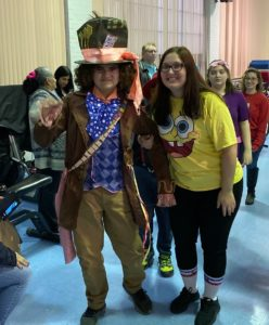 Student dressed as the Matd Hatter arrives with teacher