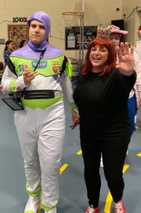 Student dressed as an astronaut arrives with teacher