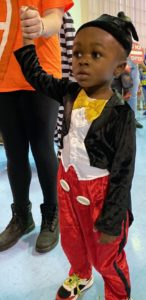 A preschooler arrives as Mickey Mouse