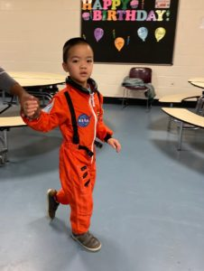 Preschooler dressed as an astronaut arrives