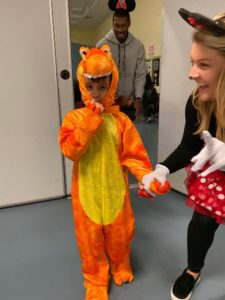 Student dressed as dinosaur enters party with teacher dressed as Minnie Mouse