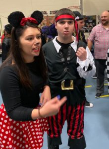 Teacher dressed as Minnie Mouse and student dressed as a pirate enjoy the festitvities