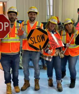 Teachers from the Silver School pose in construction costumes for Halloween party
